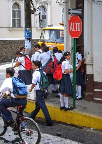 School Uniforms Around The World —marching ahead in León, Nicaragua...only one takes the time to stop and look back... Nicaragua Students Streetscape Central America Streetcorner Street Photography Cityscapes Stopsign Youth Of Today The Street Photographer - 2016 EyeEm Awards People And Places An Eye For Travel