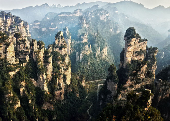 View from the BAILONG ELEVATOR, National Forest Park of Zhangjiajie - China High Landscape Layers Mountains Natural Light Nature Outdoors Peak Peaks China ZhangjiajieNationalPark Zhangjiajie Travel Destinations Tourist Attraction  Neighborhood Map The Great Outdoors - 2017 EyeEm Awards Breathing Space Lost In The Landscape Perspectives On Nature