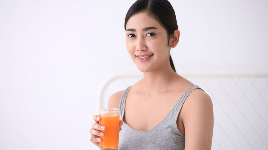 Health concept. Asian women are drinking delicious juices. Antioxidant Appetizing  Asia Faces Balance Beautiful Women Beauty Girl Beverage Bio Body Slender Choice Citrus  Control Fat Delicious Detox Diet Plan Dieting Drink Water Eco System Enjoy Fill Happiness Fresh Skin Fruit Smoothie Glass Bottle Happy Face Health Care Healthy Concept Holiday Vacation Lady Woman Lifestyle Leisure Lose Weight Low Calorie Meal Natural Product Nutritious Vegetables Obesity Rate One People Orange Juice  Organic Food Proper Nutrition Recommendation Reduce Eat Refreshing Repair System Slimming Sweet Smile Very Sour Vegetarian Food Vitamin C Vitamins Minerals Wellness Program Young Adult