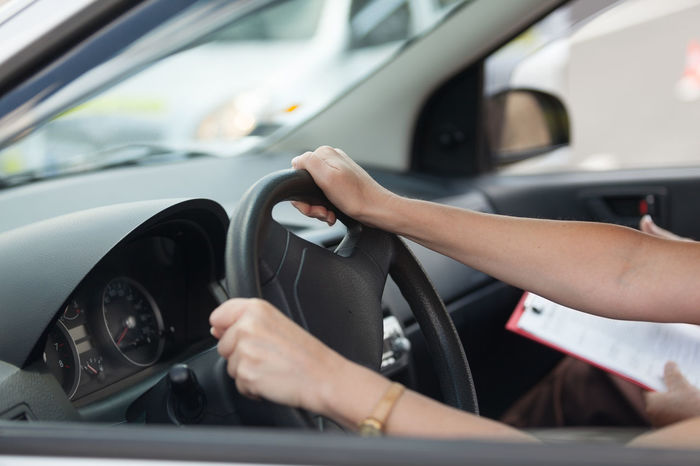 Learning to drive a car. Student driver. Driving school. Car Class Driving Car Driving Instructor Driving Lesson Driving Lessons Driving Licence Driving License Driving School Education Female Holding Human Body Part Human Hand Learning To Drive People Steering Wheel Student Driver Test Transportation Vehicle