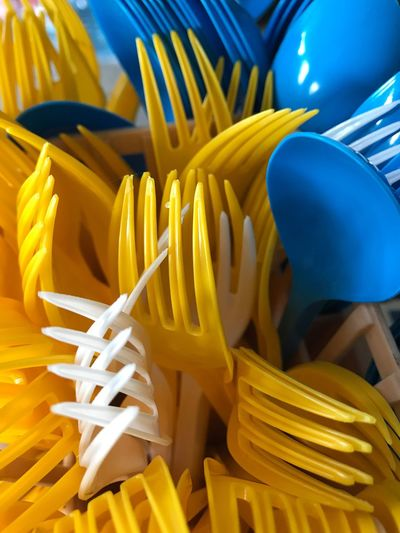 High angle view of colorful forks