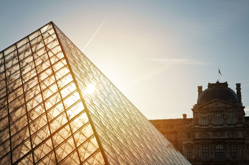 Louvre pyramid in the morning light Architecture Building Exterior Built Structure City Cityscape Day Gold Gold Colored History Louvre Louvre Pyramid Morning Light No People Outdoors Pyramid Pyramide Du Louvre Representing Sky Travel Travel Destinations
