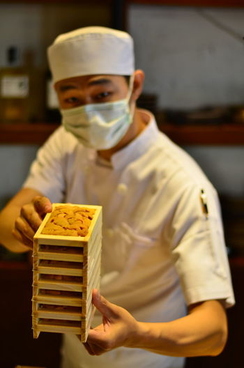 Portrait of man working in tray