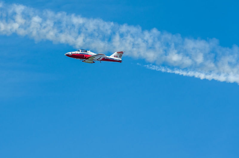 Snowbird in Flight Air Vehicle Airplane Airshow Blue Blue Sky Cloud - Sky CT-114 Tutor Day Extreme Sports Flying Freedom Jet Stream Journey Low Angle View Mid-air Mode Of Transport Motion On The Move Outdoors RCAF Royal Canadian Airforce Sky Transportation Travel