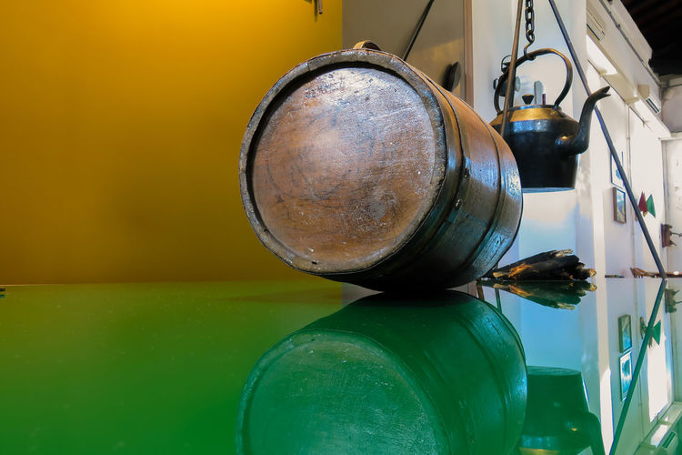 Reflection of barrel on table