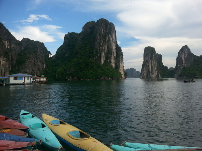 Kayaks in Halong Bay, Vietnam Halong Bay Vietnam Halong Bay  Halongbay Red Relaxing Vietnam View Beauty In Nature Blue Cloud - Sky Day Kayak Mountain Nature Outdoors Relax Relaxation Rock Sea Sky Tranquil Scene Tranquility Transportation Water Yellow