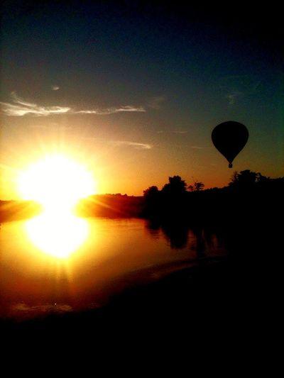 EyeEmNewHere Sunlight Hot Air Balloon Sunset Reflection Nature Sun No People Adventure Beauty In Nature Sky