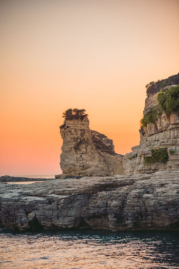 Lost In The Landscape Beauty In Nature Clear Sky Cliff Day Horizon Over Water Nature No People Orange Color Outdoors Physical Geography Rock - Object Rock Formation Scenics Sea Sky Sunset Tranquil Scene Tranquility Water
