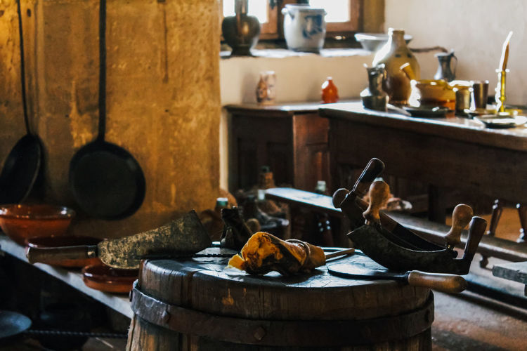 Indoors  No People Kitchen Wood - Material Table Container Domestic Kitchen Household Equipment Domestic Room Focus On Foreground Old Kitchen Utensil Still Life Home Metal Day Food And Drink Bowl Close-up Medieval Knife Food And Drink Food