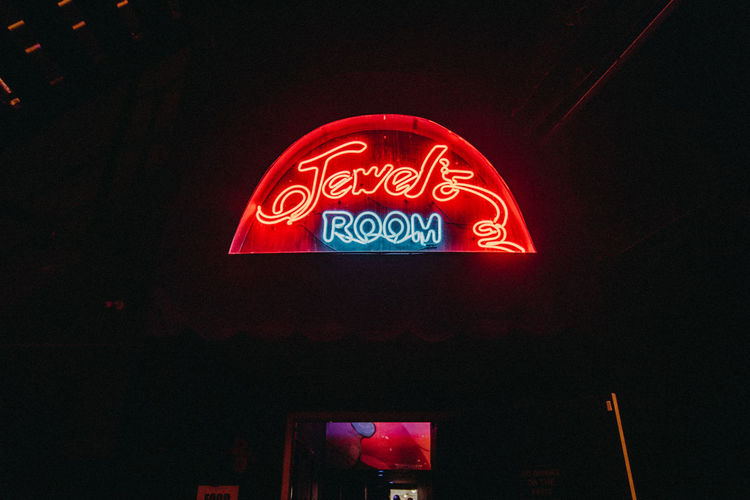 Capital Letter Commercial Sign Communication Dark Glowing Illuminated Information Information Sign Light - Natural Phenomenon Lighting Equipment Low Angle View Multi Colored Neon Neon Light Neon Lights Neon Sign Neonlights Night No People Outdoors Red Sign Text Western Script