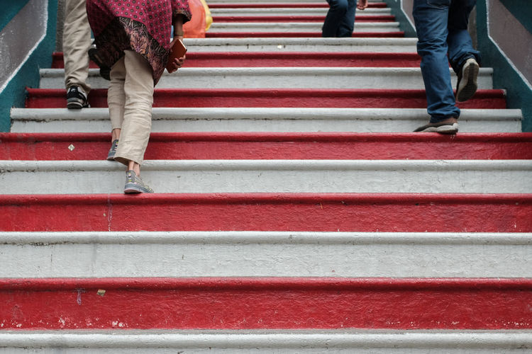 People walking up the stairs of sri subramaniam temple