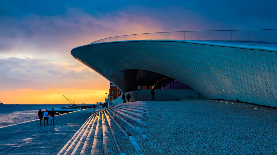 Lisbon - Portugal MAAT Museum Maat, Portugal, Belem Sunset_collection Architecture Bridge Bridge - Man Made Structure Built Structure Cloud - Sky Connection Direction Group Of People Incidental People Lifestyles Maat - Museum Men Nature Outdoors Real People Sea Sky Sunset The Way Forward Transportation Water
