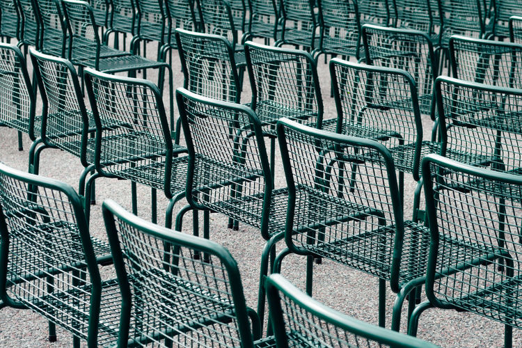 Full frame shot of empty chairs on footpath