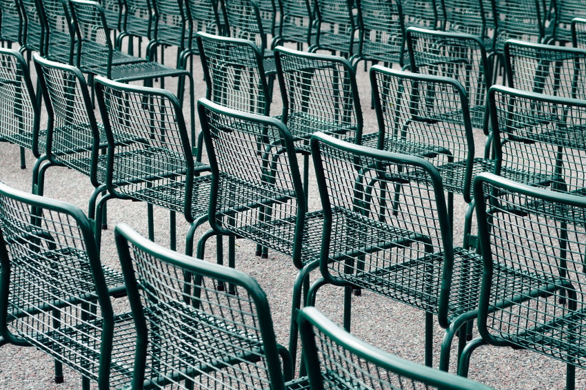 Large group of metal chairs Green Absence Architecture Arrangement Background Backgrounds Blue Chair Chairs Day Empty Full Frame In A Row Large Group Of Objects Metal No People Order Pattern Repetition Seat Silver Colored Stack