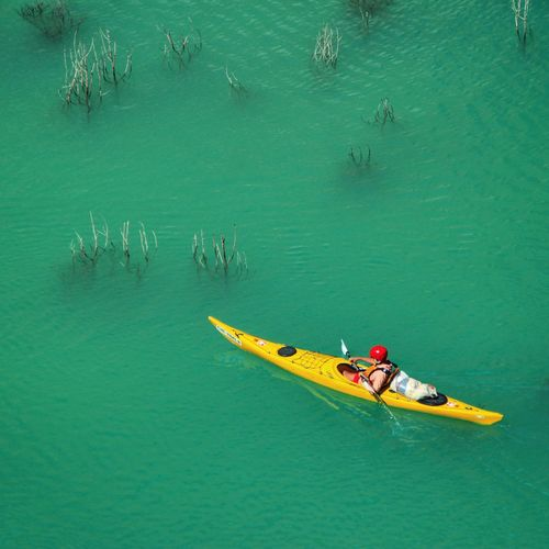 High angle view of person kayaking in sea