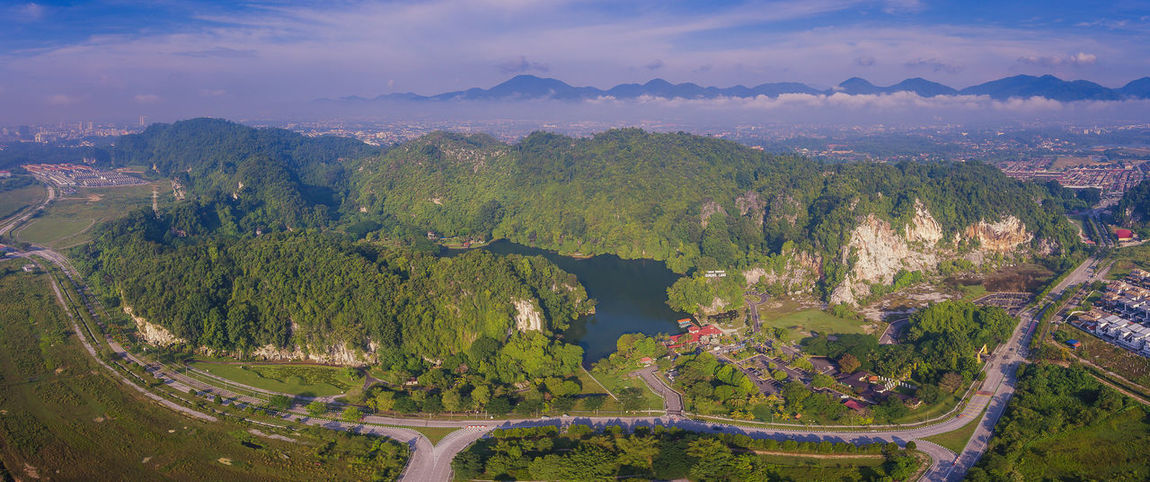 Aerial panorama view of Gunung Lang, a famous tourism place at Ipoh, Perak Malaysia Tourism Mountain Hill Aerial Ipoh Malaysia Perak Gunung Lang Tree Tea Crop Mountain Rural Scene Above Agriculture Aerial View Forest Beauty Space Drone  Panoramic