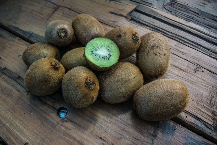 High Angle View Of Kiwi Fruits On Wooden Table