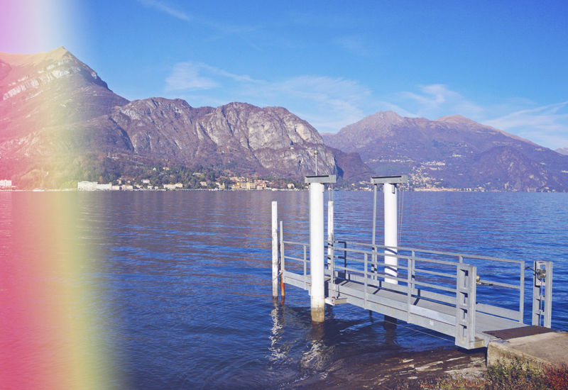 Lake Como with light leak Como Como Lake Pier Analog Blue Damaged Italy Jetty Lake Landing Stage Leaking Light Light Effect Light Leak Light Leaking Mountain No People Outdoors Rays Scenics Sky Sunlight Tranquility Vintage Water