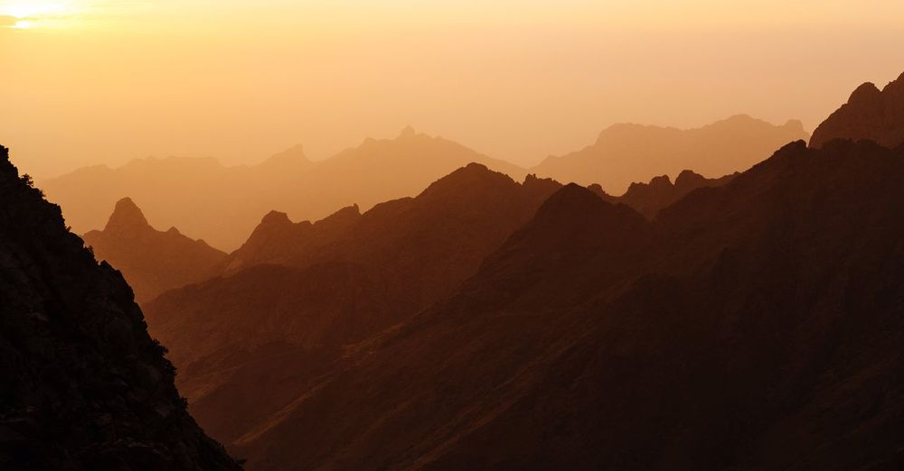 Layers of mountains Mountain Scenics - Nature Beauty In Nature Sunset Sky Landscape Mountain Range Tranquility Sun Majestic Outdoors Tranquil Scene Nature