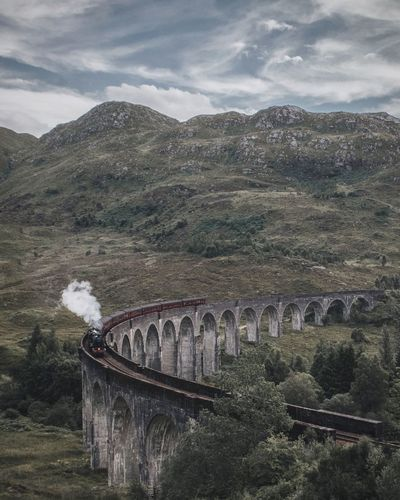 Scenic view of train on viaduct