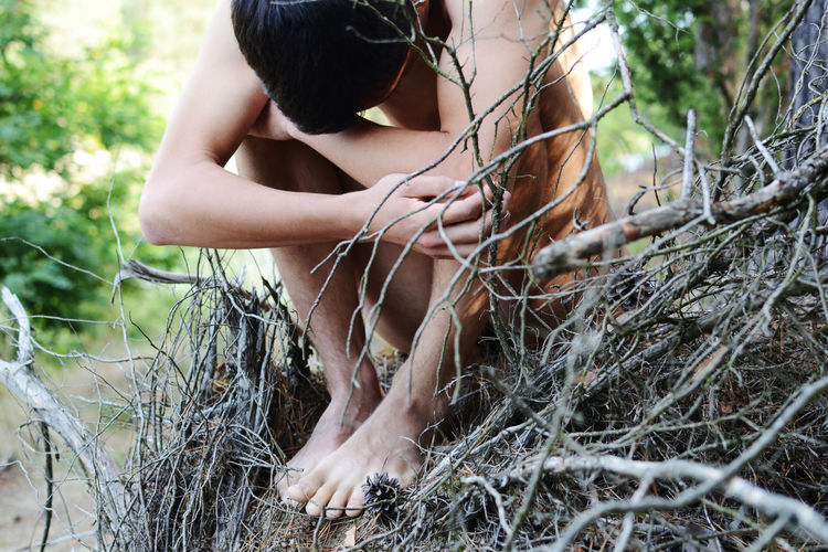 One Person Plant Land Tree Nature Real People Day Lifestyles Leisure Activity Young Adult Forest Adult Sitting Focus On Foreground Outdoors Body Part Nude_model Wildlife Wild Nature
