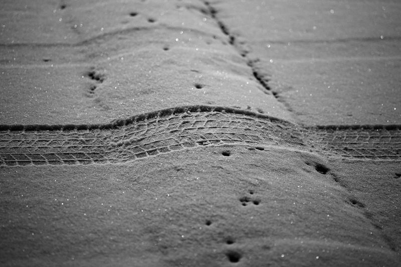 Tire tracks on sand at beach