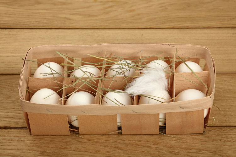 White organic chiken eggs in natural wooden carrier crate with hay Egg Container Food High Angle View White Color Eggs Box Box - Container Conteiner White Eggs Hay Organic Organic Food Fresh Cuisine Homegrown Holder Ingredient Natural Wood - Material Table