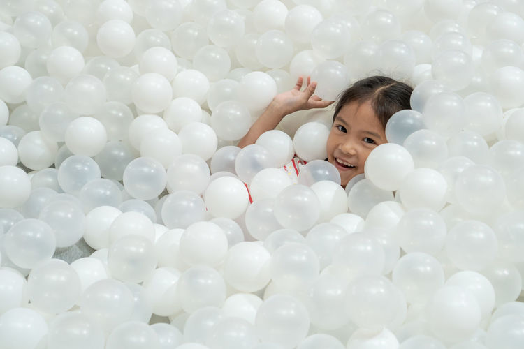 Portrait of girl playing in ball pool