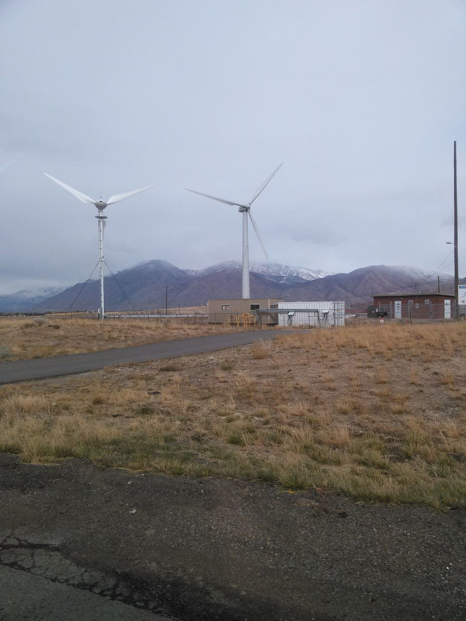 environmental conservation, wind turbine, wind power, alternative energy, renewable energy, fuel and power generation, windmill, industrial windmill, field, day, outdoors, no people, nature, landscape, rural scene, traditional windmill, mountain, sky, grass, beauty in nature