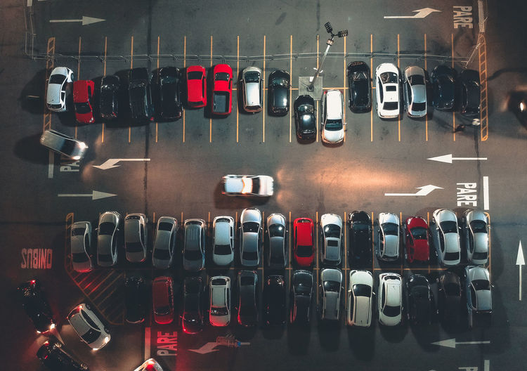 Directly above shot of cars in parking lot at night