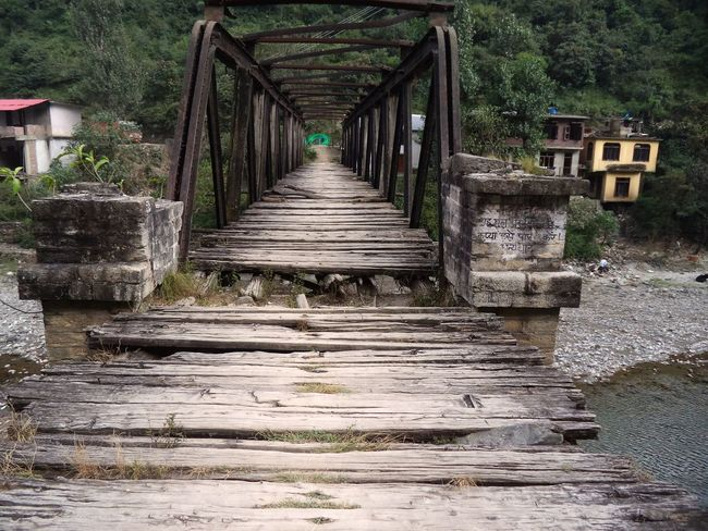 An abandoned bridge Abandoned Architecture Bridge Built Structure Day Forest Nature Nature No People Old Bridge Outdoors Rotting Wood Structure The Way Forward Transportation Tree Water Wooden Bridge
