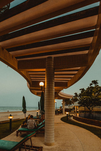 Huahin beach thailand Sky Architecture Water Real People Leisure Activity Incidental People Women Built Structure Nature Lifestyles Adult Sitting Relaxation Clear Sky Architectural Column Group Of People Holiday Travel Seat Outdoors Swimming Pool