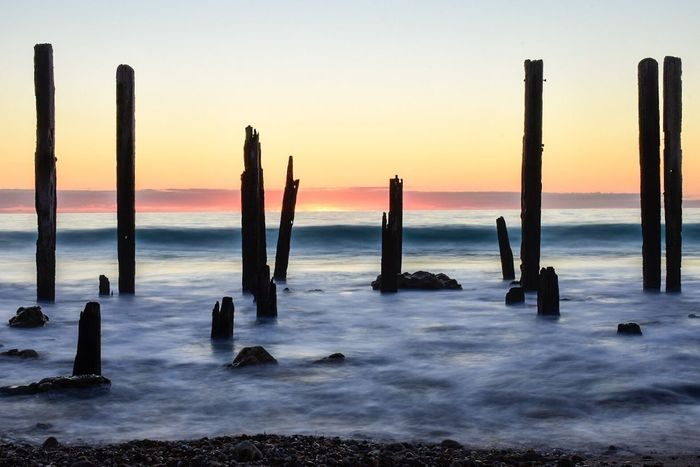 Sea Wooden Post Sunset Beauty In Nature Nature Horizon Over Water Water Tranquility No People Scenics Rock - Object Sky Outdoors Day