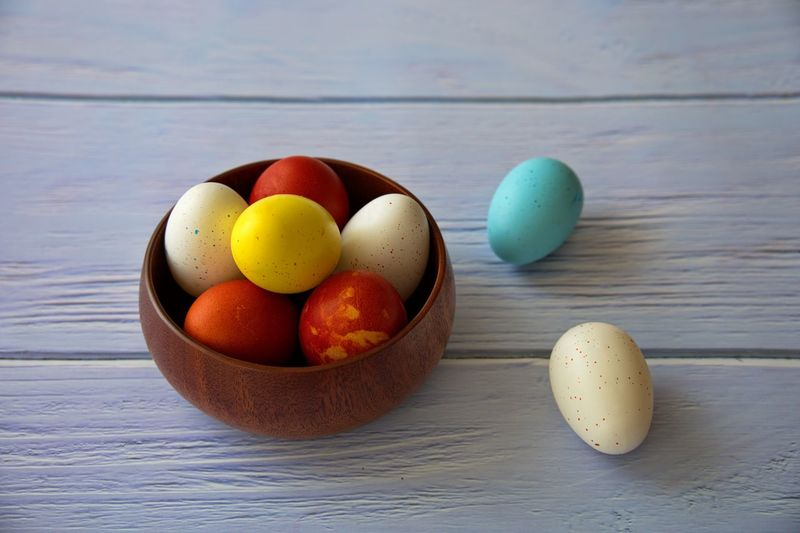 High angle view of eggs in bowl on table