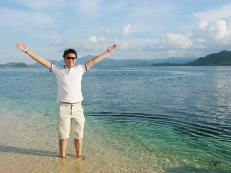 Miles Away El Nido Palawan, Something to visit in Philippines, Mountain in Sea, White Beach Sea Standing Arms Raised Vacations Travel Water Freedom Full Length Cloud - Sky One Person Arms Outstretched Beach Outdoors Enjoyment Sky Front View Human Arm One Man Only