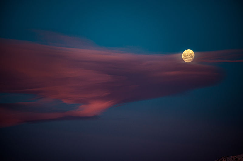 Digital composite image of moon against sky at sunset