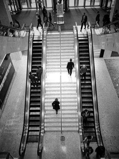 High angle view of people on stairs and escalators