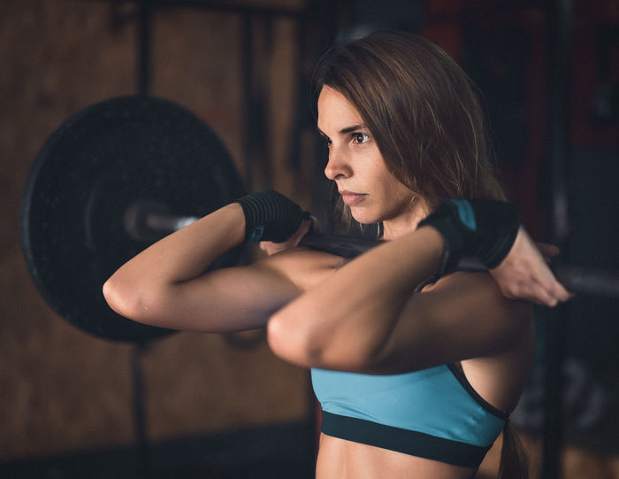 Determination Exercising Indoor Activities Musculation  Squat Athlete Blonde Exercising Close-up Cross Training Crossfit Crossfit Girl Energy Gym Kettlebell  Lifestyles Muscular Build One Person Perseverance Real People Sexygirl Sport Clothing Stretching Training Weightlifting Workout