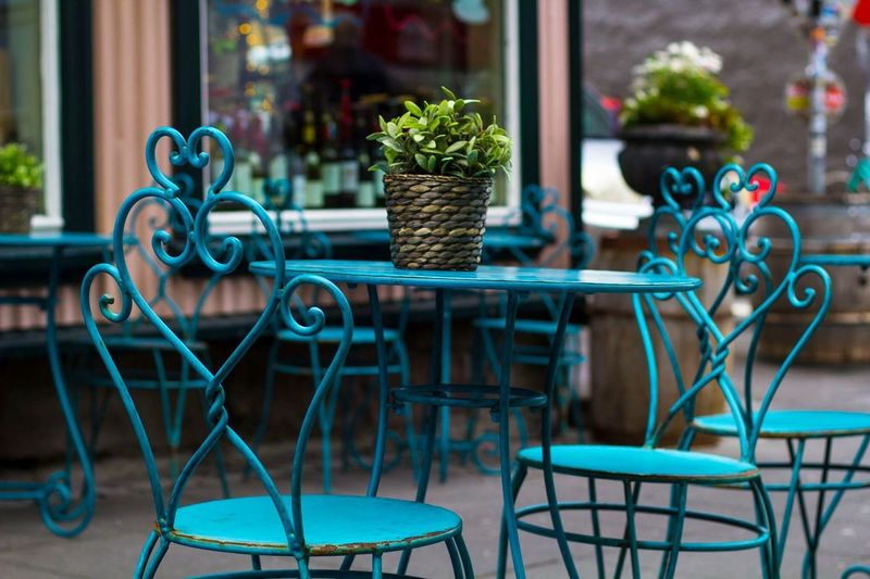 Chairs and table arranged at sidewalk cafe