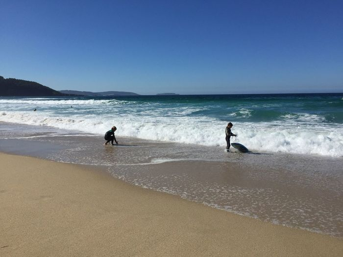 Little Surfers Beach Sea Water Land Sky Real People Beauty In Nature