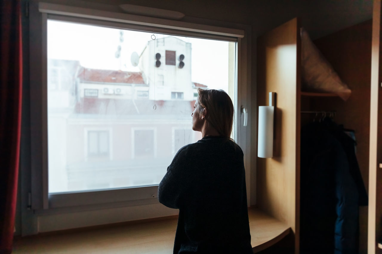 one person, window, real people, standing, indoors