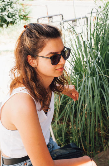 Side view of young woman wearing sunglasses
