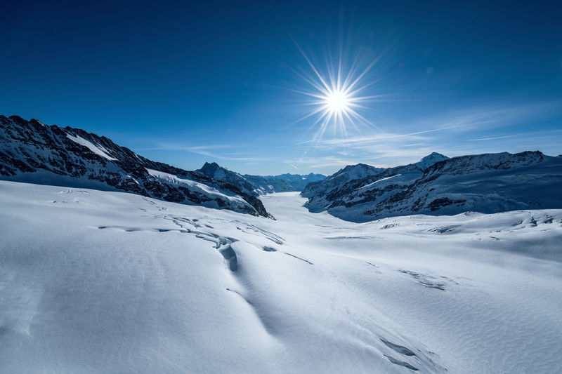 View from the Sphinx on the Jungfraujoch Swiss Alps Aletschgletscher Snowcapped Mountain Winter Cold Temperature Sunlight Snow Mountain Sun Bright Extreme Terrain Mountain Range White Color Alps Sunbeam Mountain Peak Glacier Outdoors