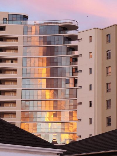 The Architect - 2016 EyeEm Awards Apartment Building Mirrored Windows Sunrise Reflecting Tinted Glass Tall Building Modern Building
