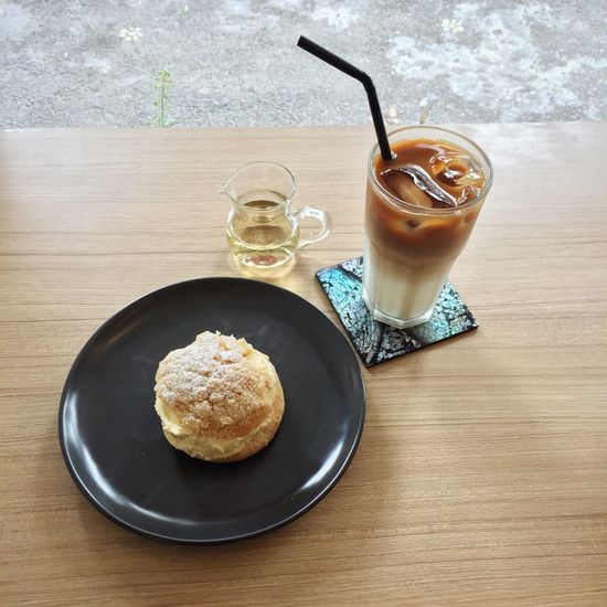 Cream puff pastry and iced latte with simple syrup on the side. Food And Drink Drink Freshness Food Table Refreshment Coffee - Drink Ready-to-eat Still Life Serving Size Indoors  Glass Cold Drink Indulgence Cream Puff Pastry Dessert Beverage Iced Latte Coffee Day