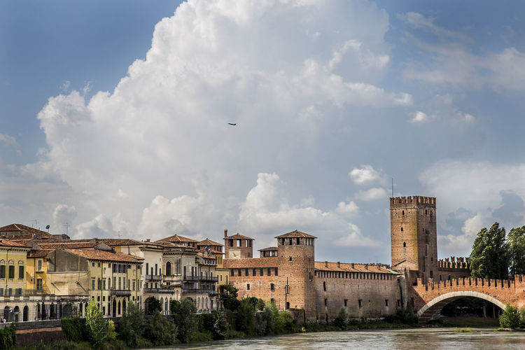Take off Adige River Castelvecchio Verona Castle Plane Verona Italy Architecture Bridge - Man Made Structure Building Exterior Built Structure Castle View  City Cloud - Sky Clouds And Sky Day No People Outdoors Sky Take Off Your Shoes Tree