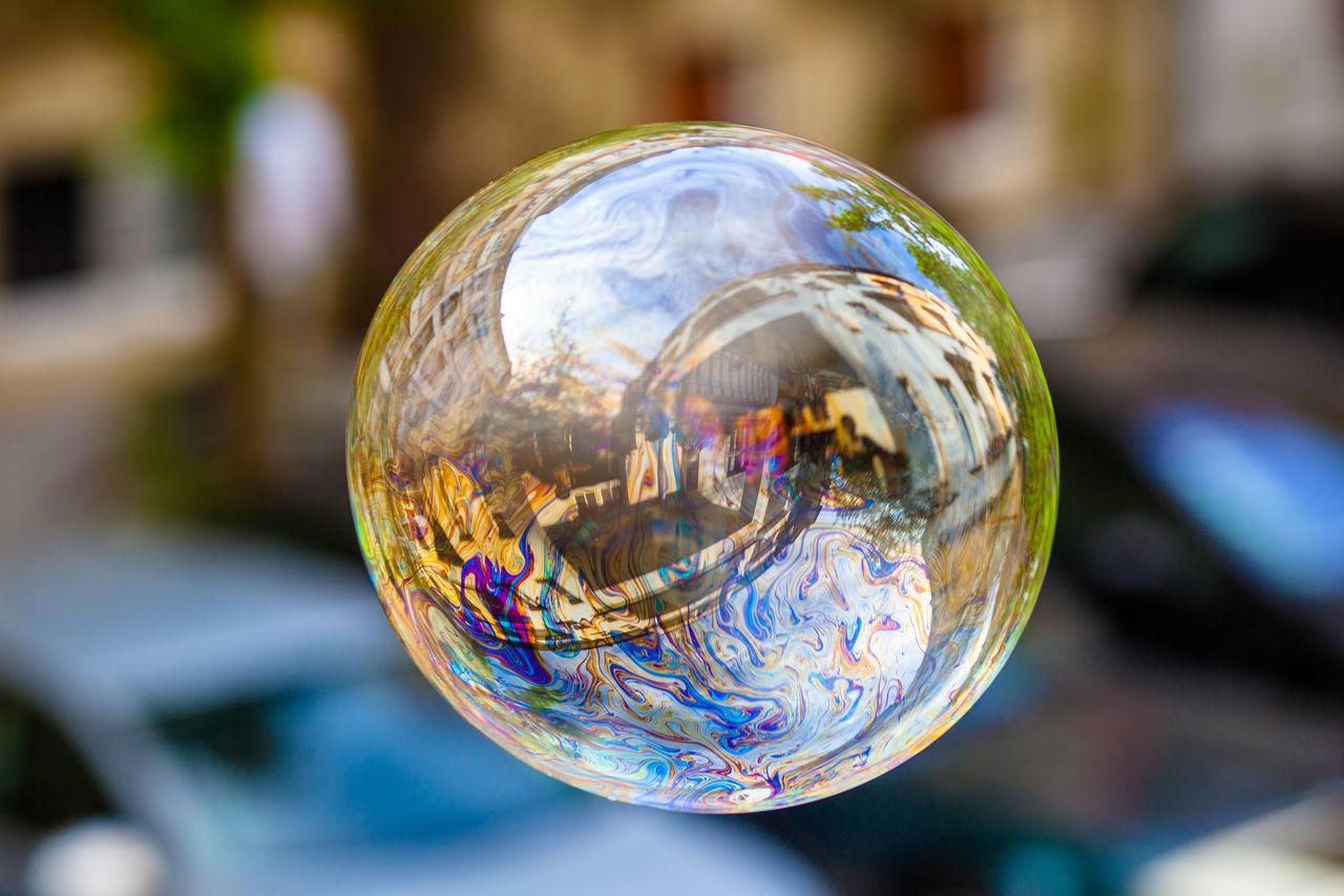 Close-up of bubble against building