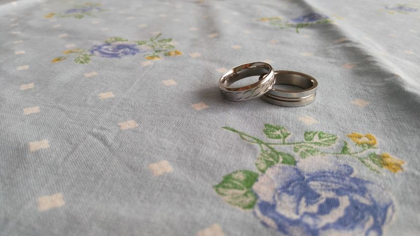Two silver rings on a table Love Couple Heart Rings Marry Wife Spouse Bride Groom And Bride Husband