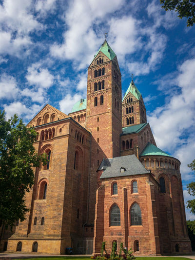 View from the southeast to historic Speyer Cathedral, Germany. It is the largest preserved romanesque church and UNESCO world heritage site Building Exterior Architecture Built Structure Sky Cloud - Sky Belief Building Place Of Worship Religion Spirituality Low Angle View Nature Tower Day History The Past Plant No People Outdoors Clock Spire  Sandstone Cathedral UNESCO World Heritage Site Landmark