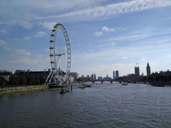 Millennium Wheel, Houses of Parliament & Big Ben in London, UK from over the Thames River City Sky Travel Destinations Bridge - Man Made Structure Ferris Wheel Outdoors Cloud - Sky Water No People Day London Wheel Observation Point Observation Wheel